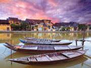 local boats docked in thu bon river in hoi an