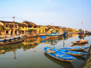 Thu bon river hoi an filled with boats on dock