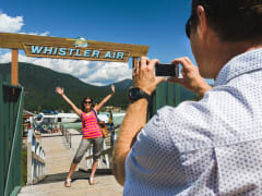 Couple in front of docks in Whistler