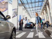Airport Transfers Woman with luggage