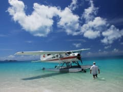 pilot and plane at whitehaven beach