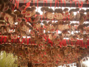 wooden blessings hanging from ceiling shuhe town