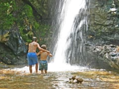USA_Hawaii_Kauai_Two_Young_Boys_at_Waterfall