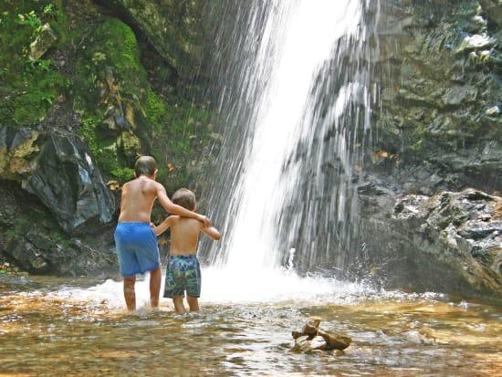 USA_Hawaii_Kauai_Two_Young_Boys_at_Waterfall