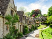 UK_England_Cotswolds_Bibury_Old_Street_Houses_Village_shutterstock_604331744