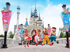 lotte world korea mascots in front of castle