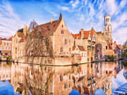 Belgium_Bruges_canal_tower_Belfort_and_ houses_shutterstock_466133975