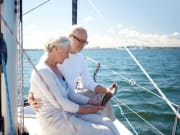Hawaii_Oahu_Older_Couple_Reminiscing_on_Boat_shutterstock_491348107