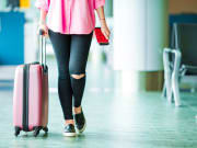 Generic_Airport_Woman-with-Pink-Luggage_shutterstock_457839016