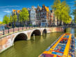 Amsterdam_canal_boat_shutterstock_662087905