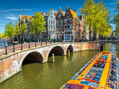 Amsterdam_canal_boat_shutterstock_662087905