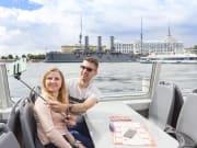 st petersburg  boat cruise travelers taking photos