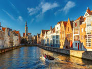 Belgium_Bruges_canal_Spiegelrei_and_Jan_Van_Eyck_Square_Morning_Boat_shutterstock_384744043