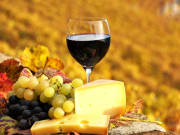 Glass of wine, grapes, and cheese