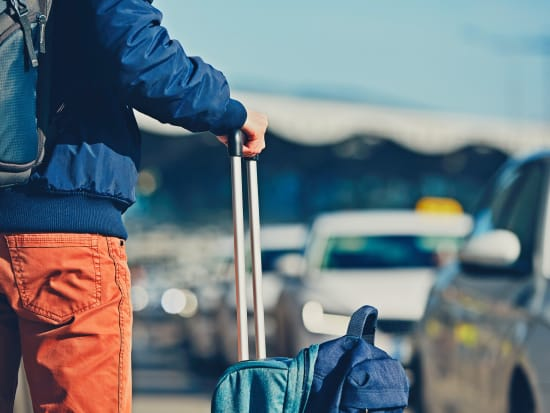 airport passenger waiting for private car