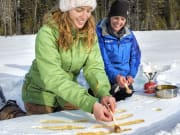 Hot-Taffy-Treat-on-the-Snowshoeing-Tour-to-Marble-Canyon