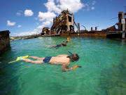 boys snorkeling at tangalooma ship wreck