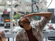 man eating last bite of hamburger in melbourne