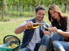 couple enjoying local white wine in hunter valley