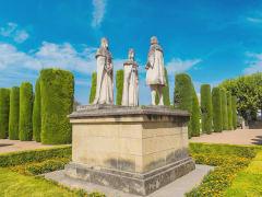 Ferdinan, Isabella and Christopher Columbus in Alcazar de los Reyes Cristianos_shutterstock_612330239