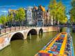 Netherlands_Amsterdam_canal_boat_shutterstock_662087905