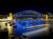 sydney harbour bridge with blue lights and decors