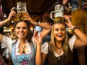 Oktoberfest partygoers in dirndls
