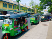 Hop on an iconic tuk tuk and explore Bangkok