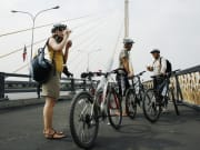 Bike through the iconic Rama VIII Bridge