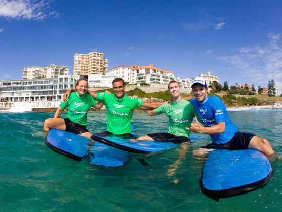 Lets Go Surfing Group photo on paddle board