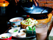 Cook traditional dishes in Nakhon Nayon