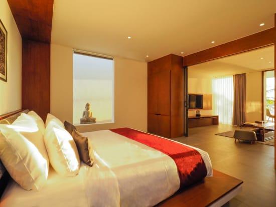 riverfront_suites_bedroom_overlooking_living_room