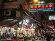 Neon lights all over Hong Kong's busy streets