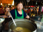 vendor scooping out local Taiwanese food