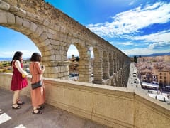 Tourists on looking at the Aqueduct of Segovia