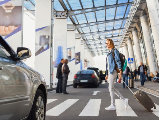 woman crossing pedestrian lane in the airport