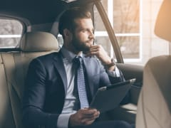 man sitting inside car private airport transfer