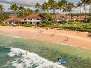 surfing-poipu-beach-kauai-900x350
