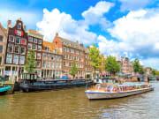 netherland_amsterdam_canal-boat-tour_shutterstock_246720346