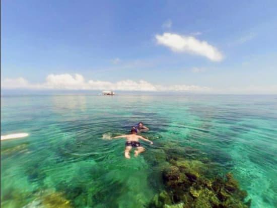 cebu mactan nalusuan island couple snorkeling