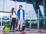 Generic_Airport_Asian-Couple-with-Luggage