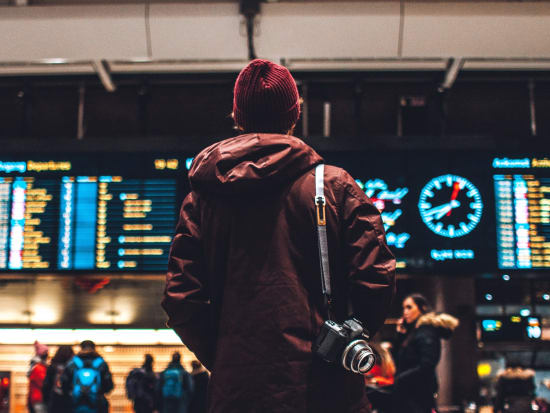 hobart airport man looking at flight schedule