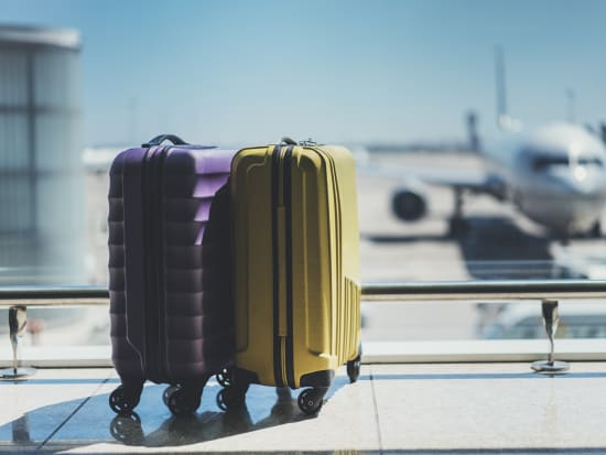 yellow purple suitcases airplane on background