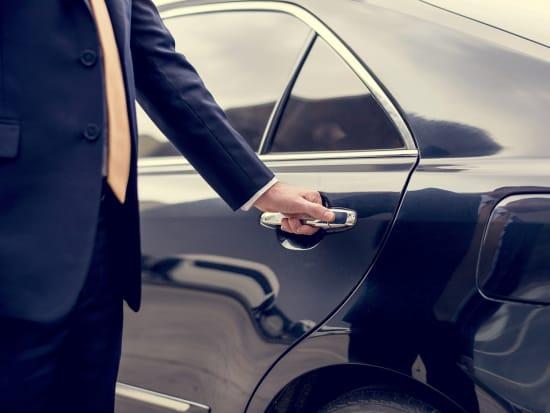 driver opening car door for passenger