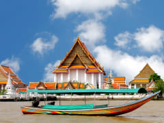 Cruise down Chao Phraya River on a long-tail boat