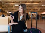woman waiting inside terminal
