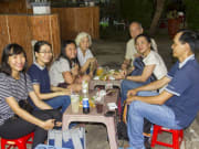 Ho Chi Minh food tour tourists eating local dishes