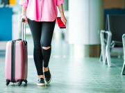 Airport Woman with Pink Luggage