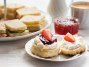 Tea sandwiches, pastries, cups