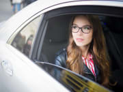 Generic_Girl_in_Car_Transfer_shutterstock_1051151252